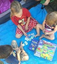 3 kids playing board games